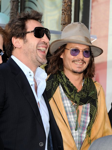 javier-bardem-and-johnny-depp-1301916607-view-0
